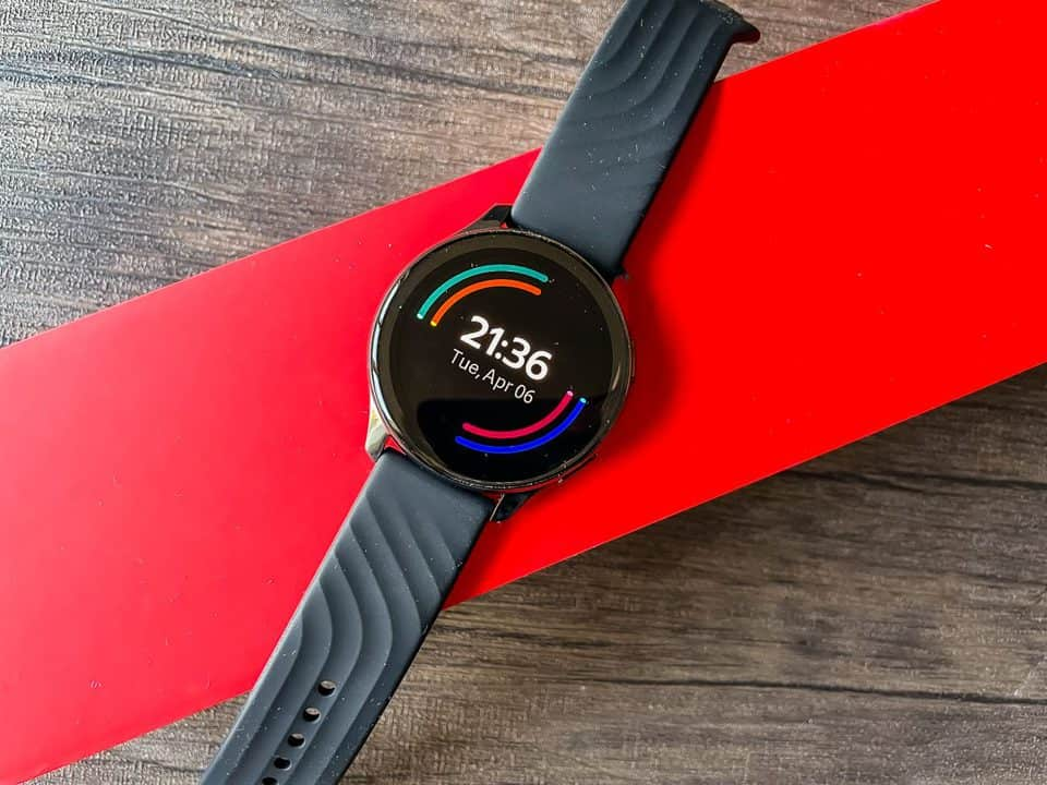 one plus watch on a red box