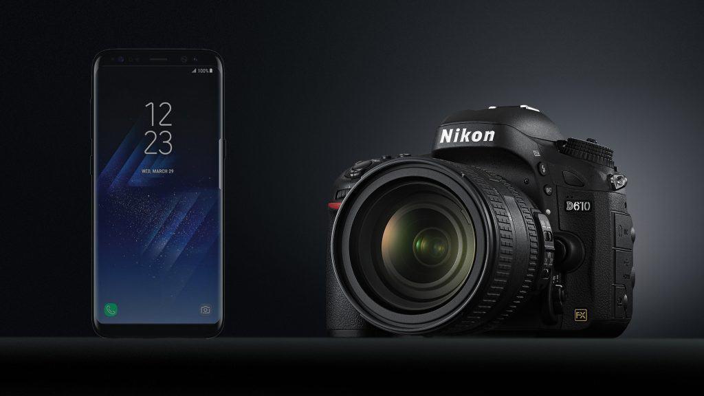 dslr camera next to a smartphone
